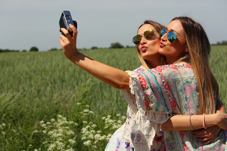 portrait of a beautiful young female twins. selfie concept