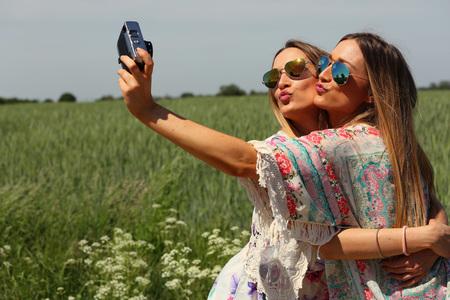 portrait of a beautiful young female twins. selfie concept Zdjęcie Seryjne - 57038097