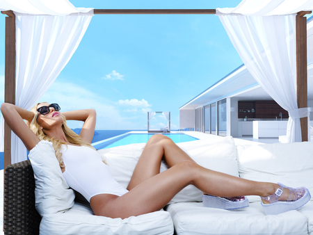 cabana: woman relaxing in a cabana. 3d rendering Stock Photo
