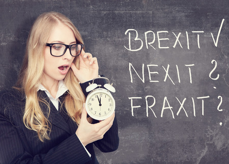 sceptic: Brexit is done. who ist next concept. woman with a alarm clock. Stock Photo
