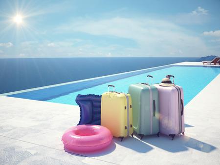 ropa de verano: colorido maleta y un sombrero blanco al lado de la piscina Foto de archivo