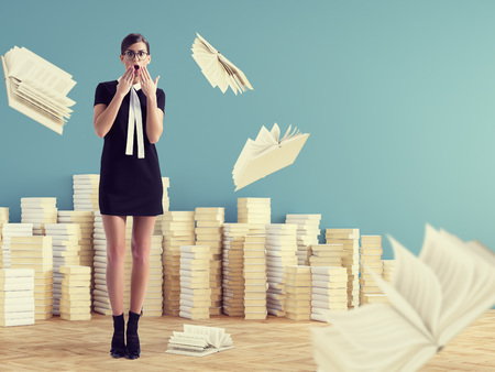 young woman standing infront of stack books. education concept. Stock Photo