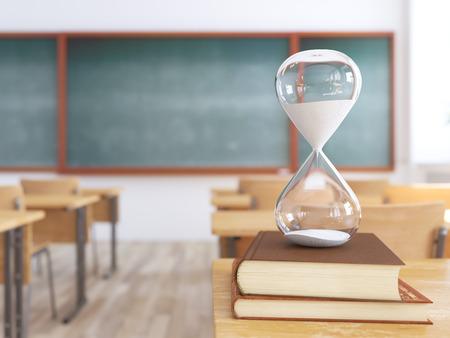 sandglass on books in empty school classroom. 3d rendering