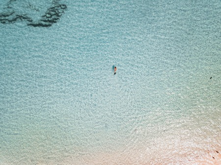Female snorkeler in turquoise waters. exuma bahamas