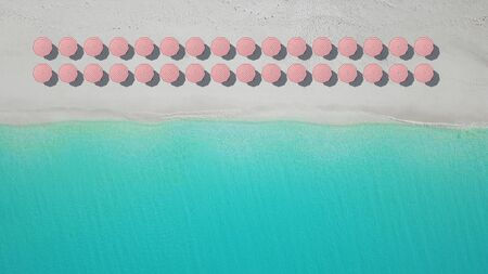 aerial top view on the beach with lots of beach umbrella.