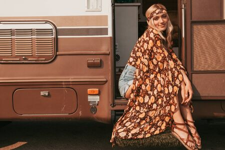 retro campervan with hippie californiagirl. california van lifestyle Banque d'images - 133982533
