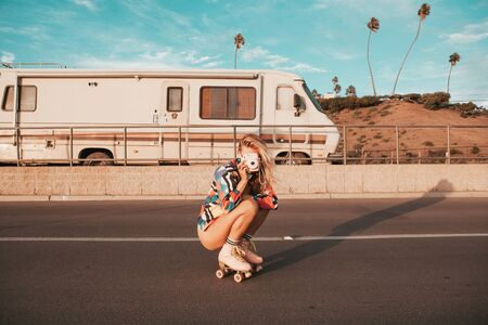 retro styled skater girl with a camper van in the background