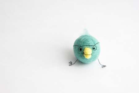 Miniature needle felted baby bird, wool handmade toy Imagens - 27015350
