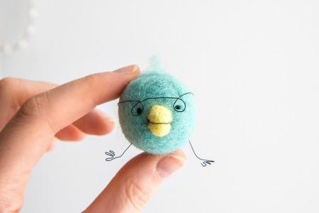 Miniature needle felted baby bird, wool handmade toy Imagens - 27038379