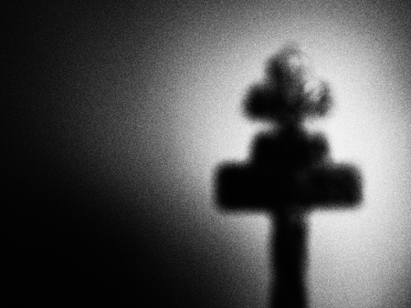 dreadful: Artistic black and white photograph of defocused cross Stock Photo