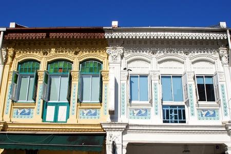scraper: old chinatown wooden building agianst modern sky scraper singapore