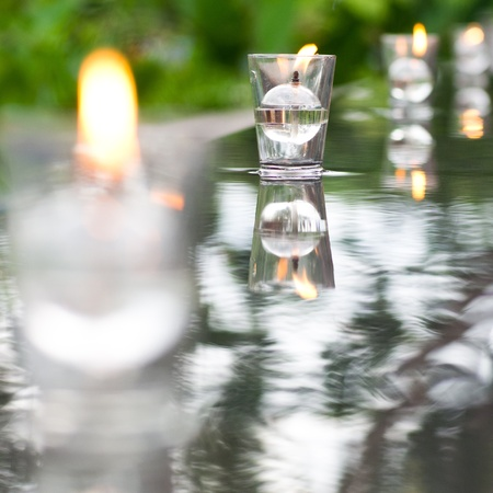 candle on pool water Stock Photo