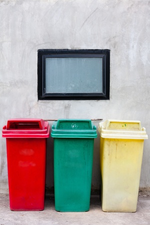 three recycle bin on wall photo