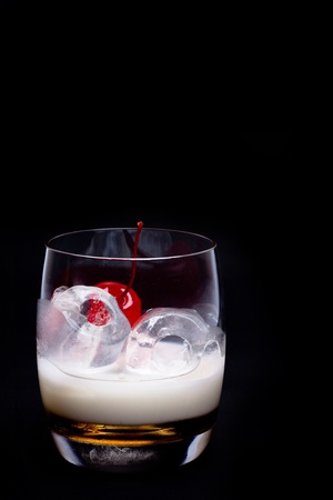 White Russian Cocktail - isolated on black