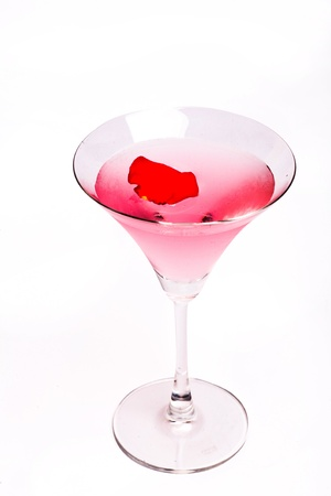 Cosmopolitan cocktail with rose in top of a white background Stock Photo - 14512907