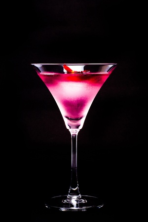 Cosmopolitan cocktail with rose in top of a black background photo