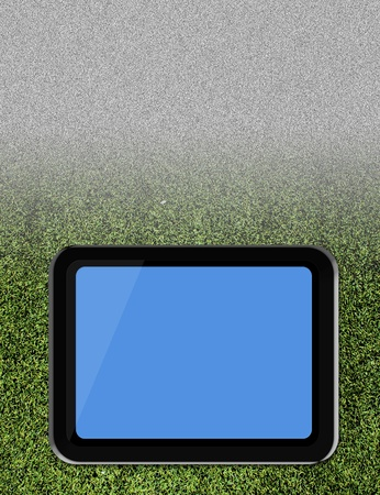 Tablet pc on soccer grass field Stock Photo - 14512932