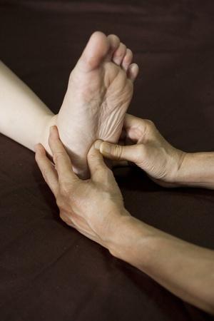 reflexology foot massage, spa foot treatment Stock Photo - 14618150