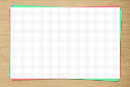 graph paper on wooden desk photo