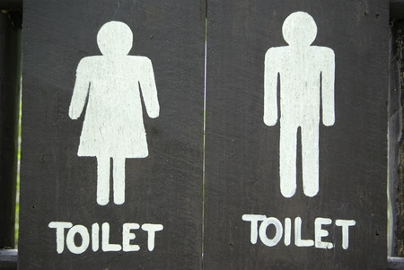 Ancient toilet sign on wood photo