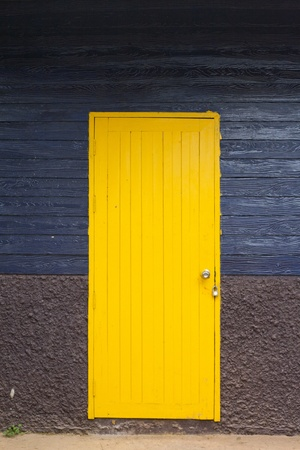 yellow door, blue wall photo