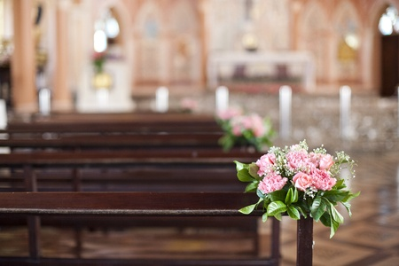 church interior: Beautiful flower wedding decoration in a church