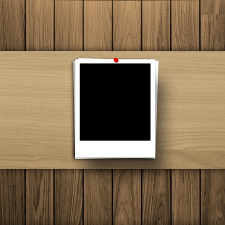 blank photo frame on wooden texture background