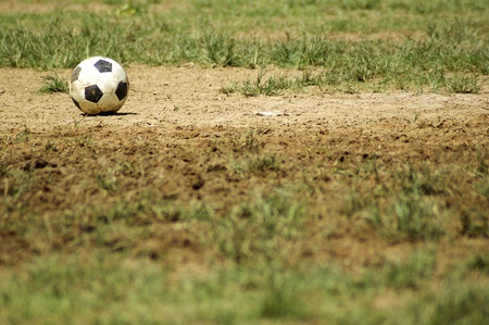 Old Soccer Ball  Poor school soccer field  Charity  photo