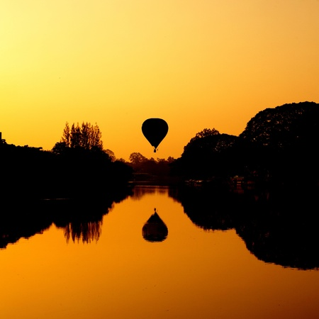 Hot Air Balloon at Sunrise on the river Stock Photo - 15159216