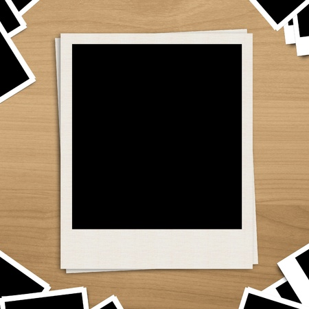 blank photo frame on brown wooden background photo