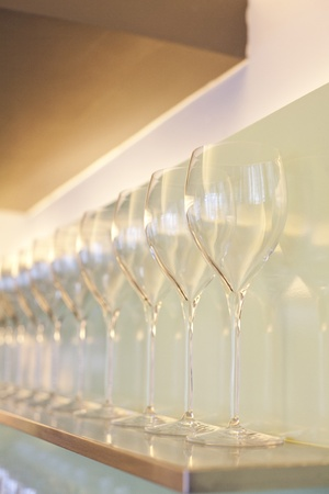 Restaurant rack with  wine glasses photo