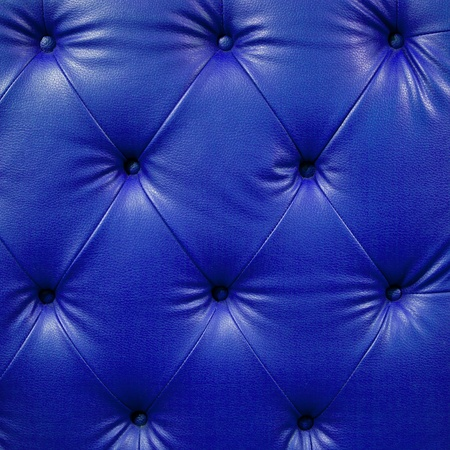 Close up blue luxury buttoned black leather photo