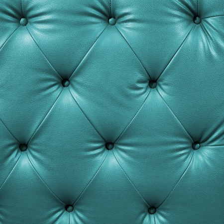 Close up cyan luxury buttoned black leather Stock Photo