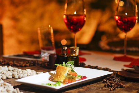 Romantic salmon steak dinner with red wine photo