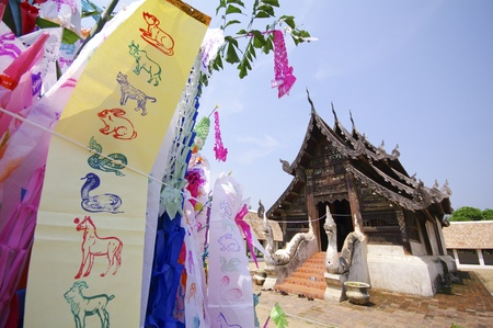Flag hang Songkran Festival  One of the traditions of northern Thailand  The Hang Tung and colorful embroidery  The pagoda is made of sand photo