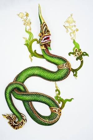 thai believe: Thai style green dragon on white wall Editorial