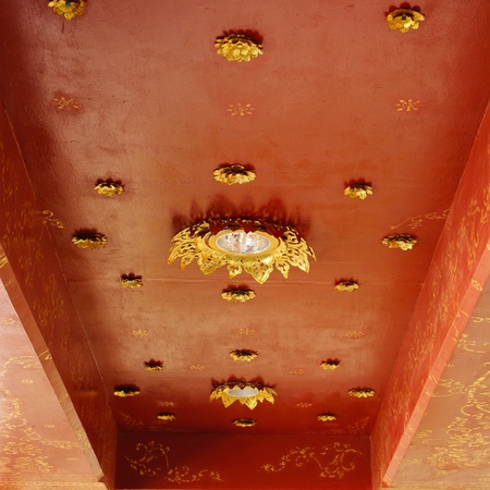 Golden on red thai, Buddha temple ceiling decoration photo