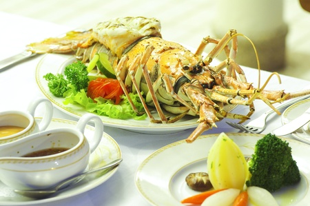 wine sauce: Lobster food on dining table in restaurant Stock Photo