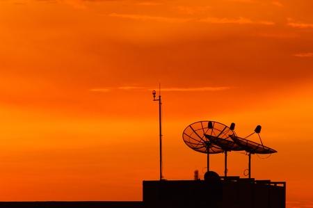 Satellite dish at sunset Stock Photo - 15154155