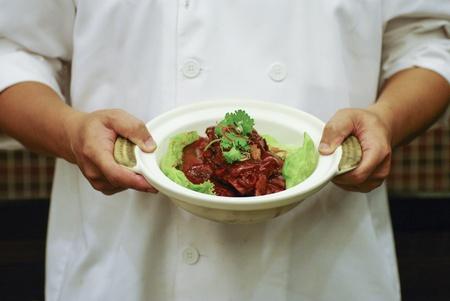 dongpo: Braised pork on chef hand