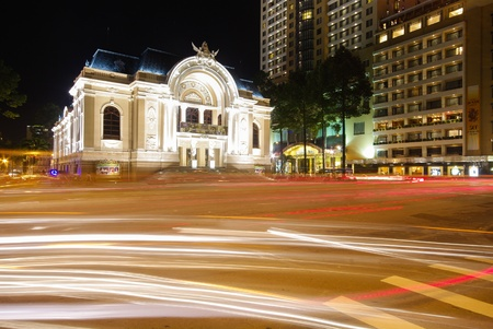 south east: The opera house of Saigon Vietnam with stream of passing traffics