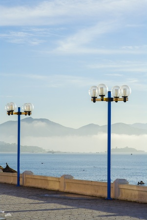 electric avenue: Street light against sea and mountain background