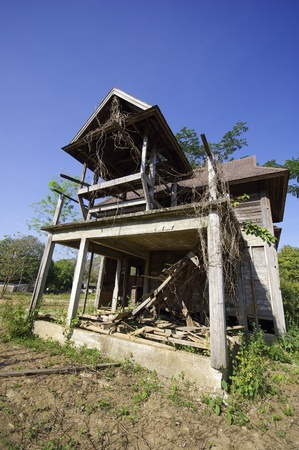 broken house: Abandoned house on blue sky background Stock Photo