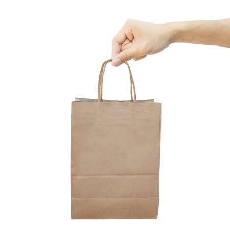 Hand With Paper Shopping Bag Isolated On White Stock Photo - 17158953