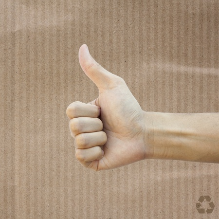 Like hand on Recycle paper texture background photo