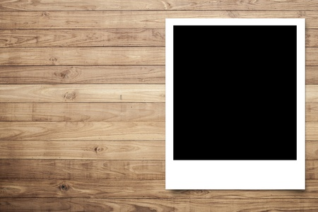 Photo frame on Brown wood plank wall texture background photo