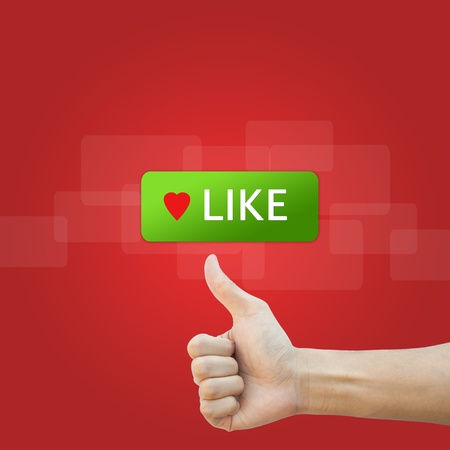 like button with real hand on red background Stock Photo - 17886794