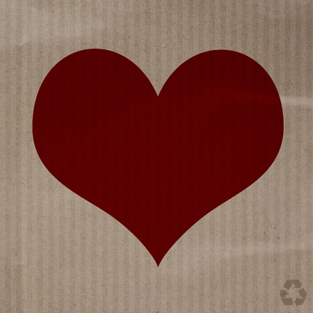 Love heart on recycle paper texture background photo