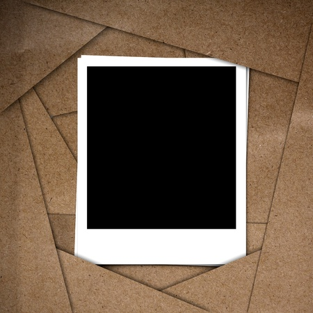 polariod: Photo frame on Brown abstract paper recycle background