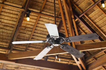 Tropical wooden colonial style ceiling fan stock photo picture and vintage fan on wood ceiling photo aloadofball Image collections